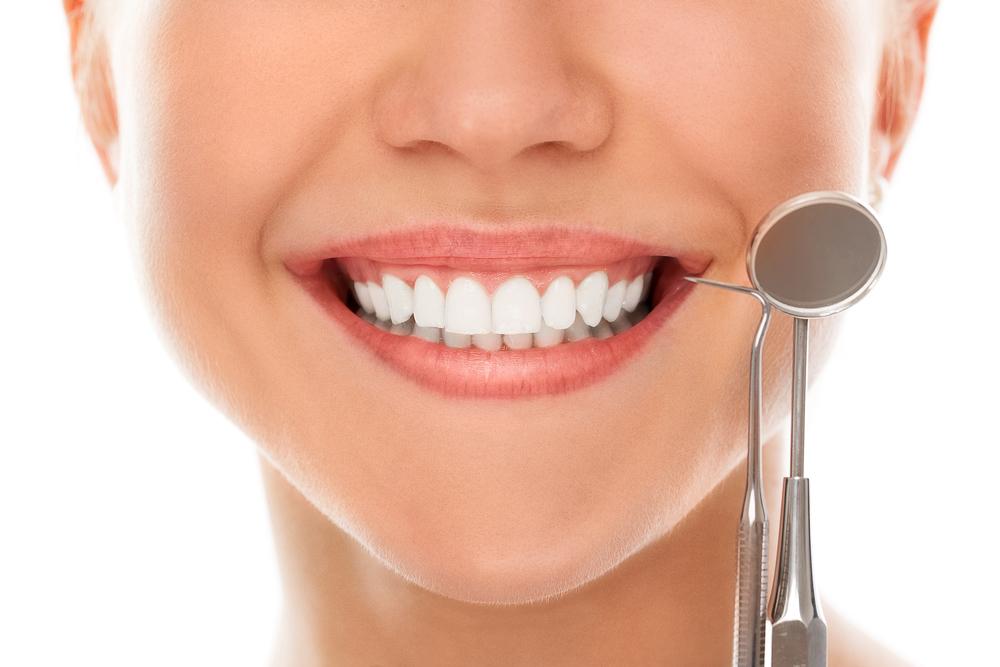 Sunde tænder giver plus på den generelle velvære